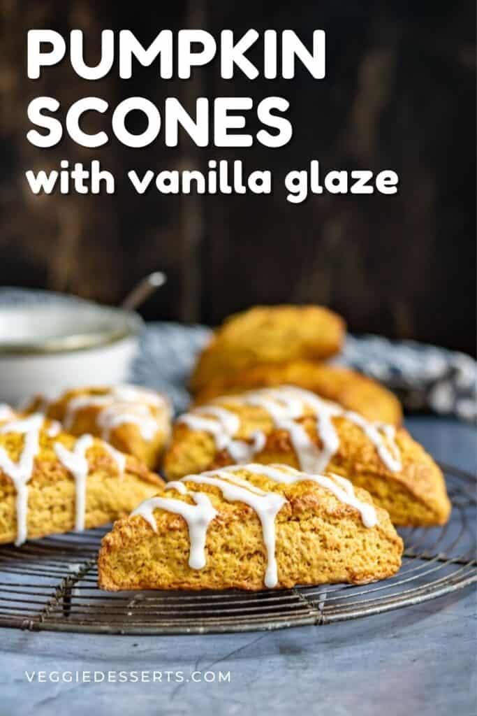 Scones on a rack, with text: Pumpkin Scones with Vanilla Glaze.