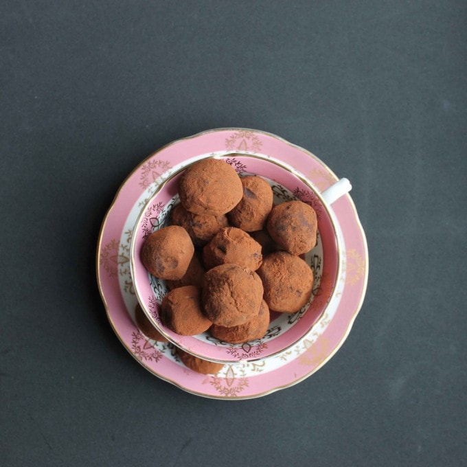 Beetroot Chocolate and Smokey Lapsang Souchong Tea Truffles recipe in a pink vintage teacup on black background