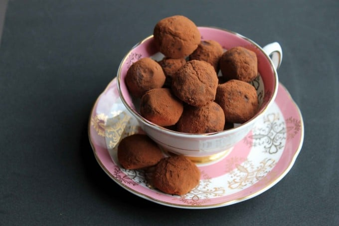 A vintage teacup full of chocolate truffles.