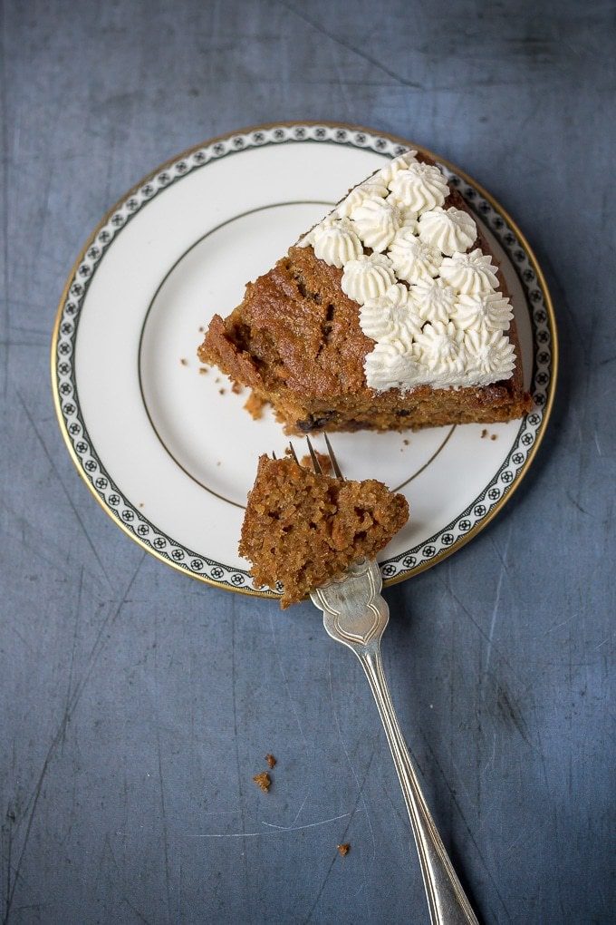 A slice of fluffy and moist easy carrot cake. This nut-free recipe is lighter with yogurt instead of half the oil.