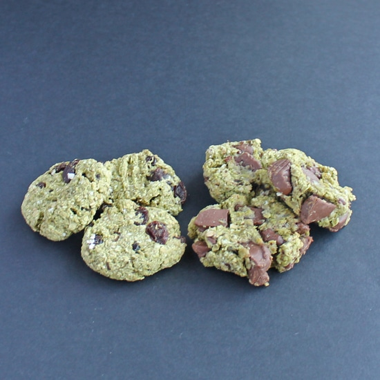 avocado cookies with raisins or chocolate on a black background