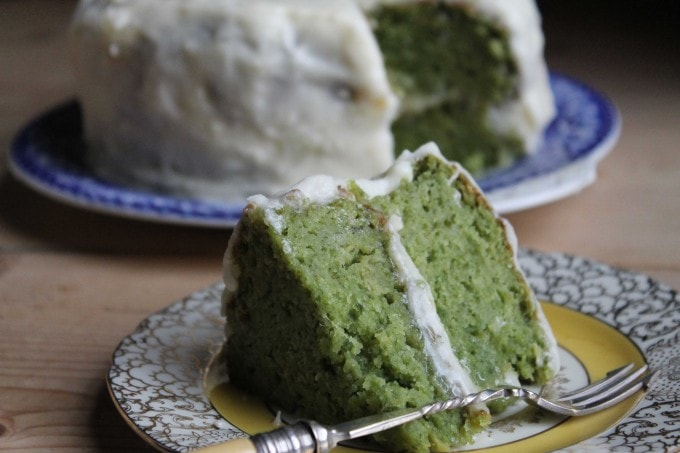 A slice of naturally bright green kale cake. The flavour of the kale fades away so it tastes like apple cake - except it's green! It's light and fluffy.