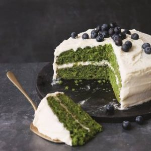 This bright green cake is made with kale! This kale and apple cake is light and fluffy and you can't taste the kale - though it leaves behind goodness and a vibrant green colour. It tastes like a fluffy apple layer cake.