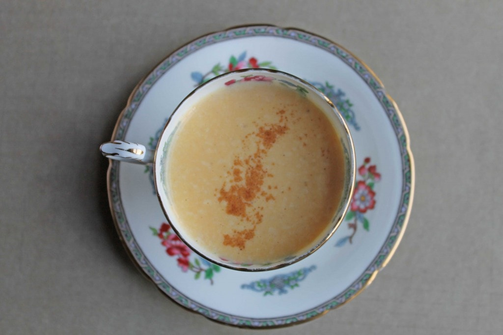 Looking down at a Sweet Potato Latte in a vintage teacup.