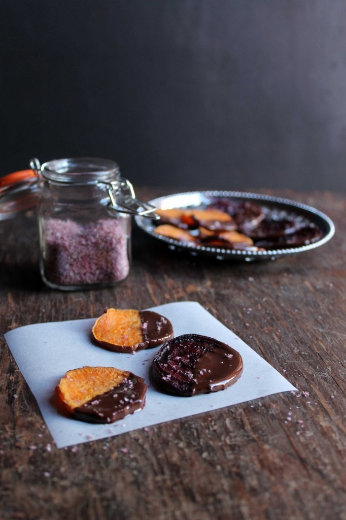 Chocolate covered beets and sweet potatoes on a paper.