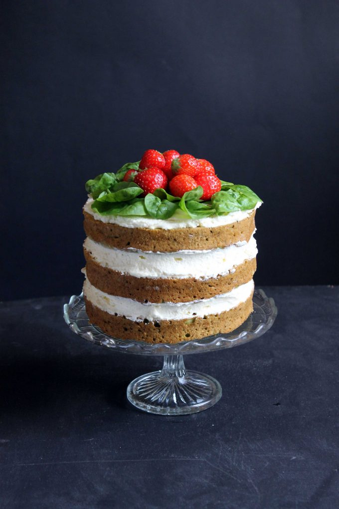 Spinach Coconut Yogurt Cake with strawberries on top