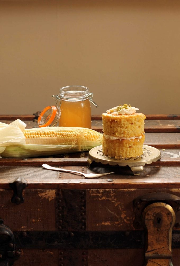 Sweet Corn and Coconut Mini Cakes on a vintage trunk next to a jar ofCorn Cob Jelly