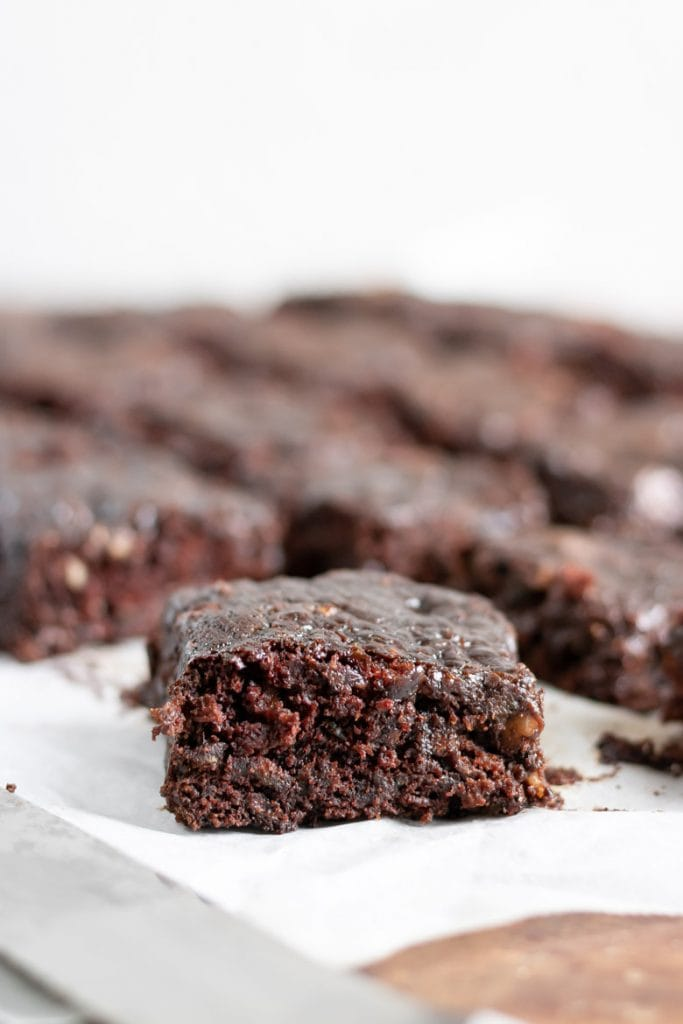 Close up of a vegan courgette brownie recipe with others in the background