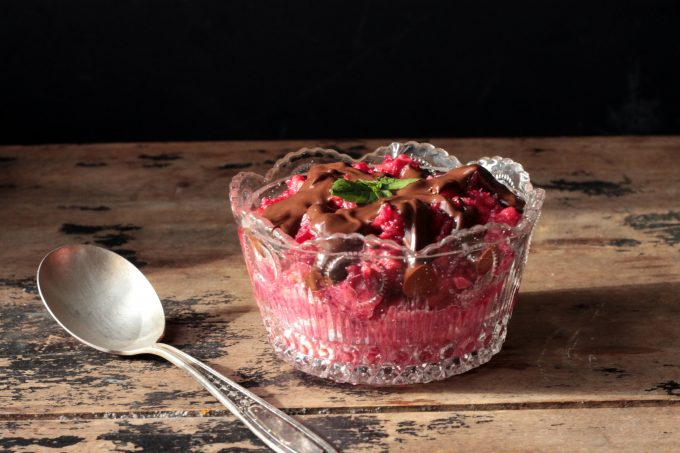 A glass bowl of beet chocolate risotto.