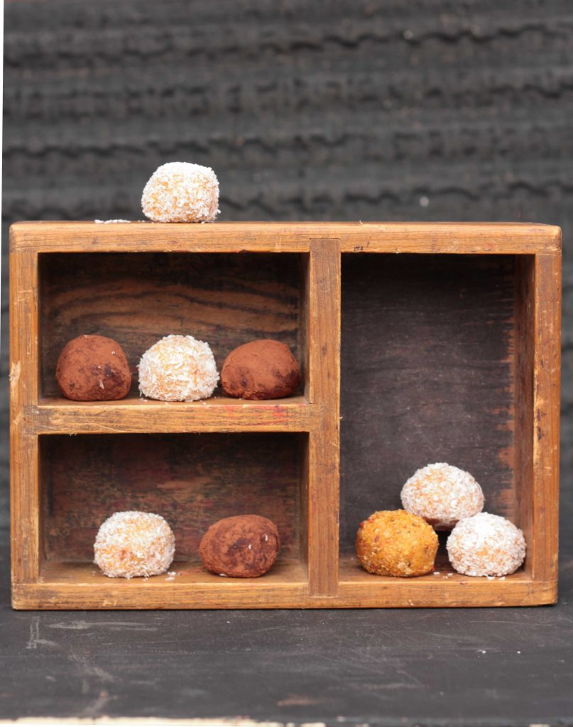 Sweet potato balls on a wooden box.