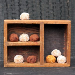 A wooden box full of sweet potato balls.
