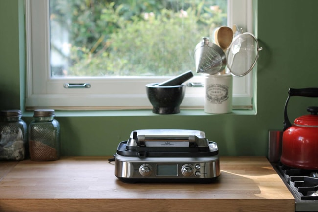 Waffle maker on kitchen counter.