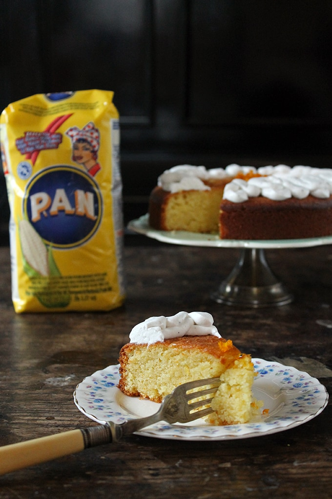 Slice of cake in front of bag of pan corn flour.