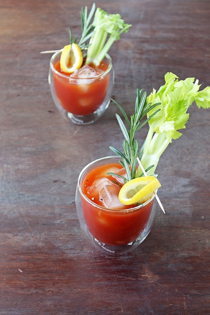 Two glasses of Bloody Mary with celery stalks.