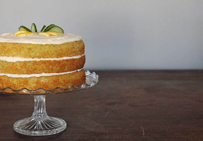 A Lemon and Cucumber Cake with Gin Icing on a vintage glass cake stand