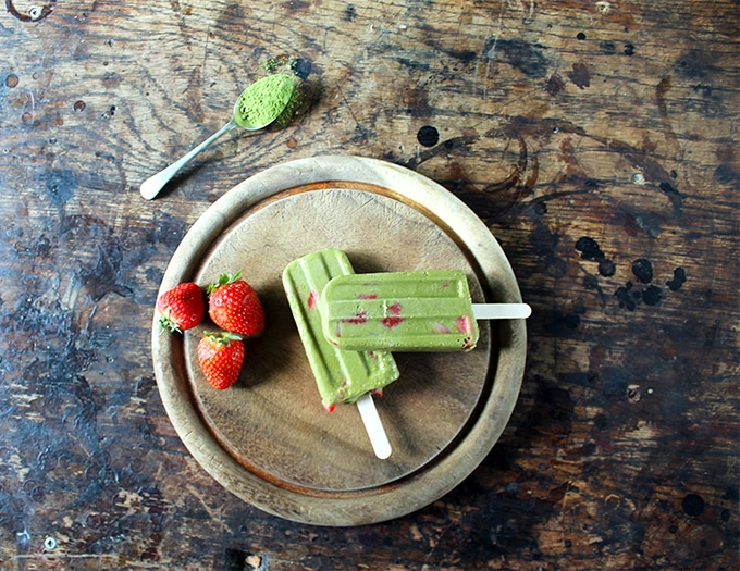Popsicles on a wooden board.