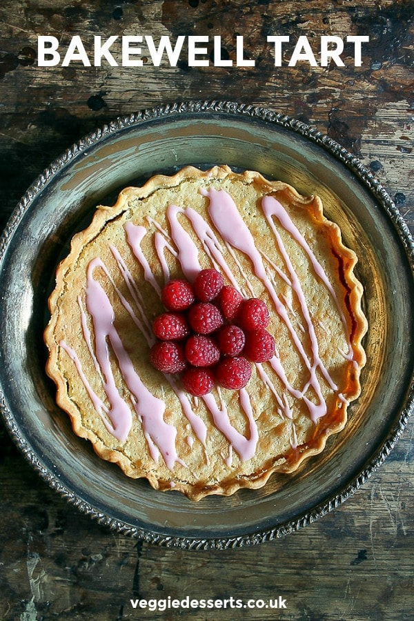 Bakewell tart - pinnable image. A shortcrust pastry case with raspberry jam and almond frangipane.