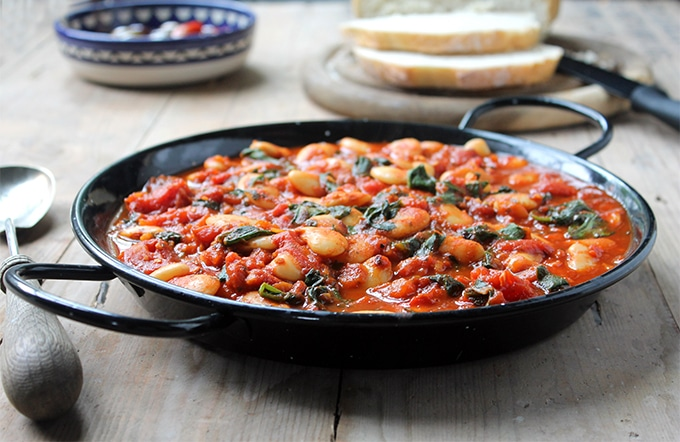 A large bowl of Spanish Beans and Tomatoes - a quick and easy meal that's bursting with flavour. Vegan and gluten free.