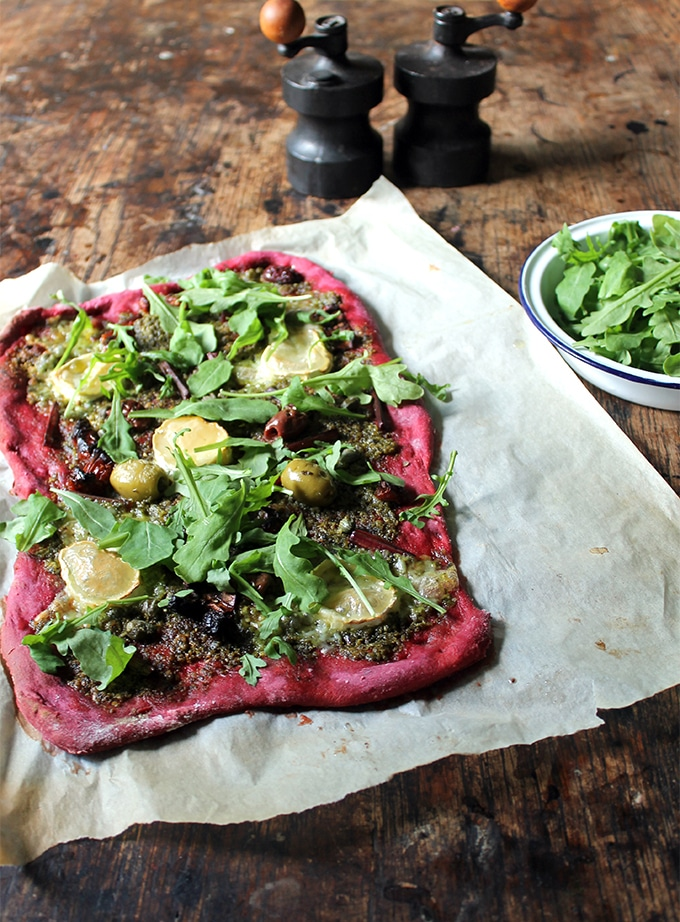 A bright purple beet pizza. The vegan pizza crust is a wonderful colour, but you can't taste the beetroot. It's topped with beet leaf pesto.
