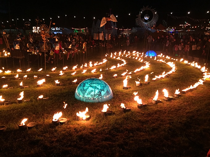 Candles in circles in a field.
