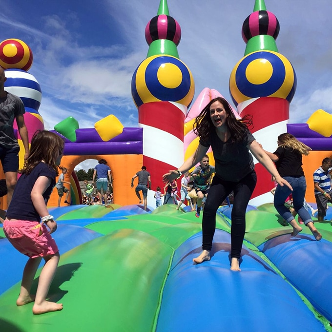 People jumping in a big bouncy castle.