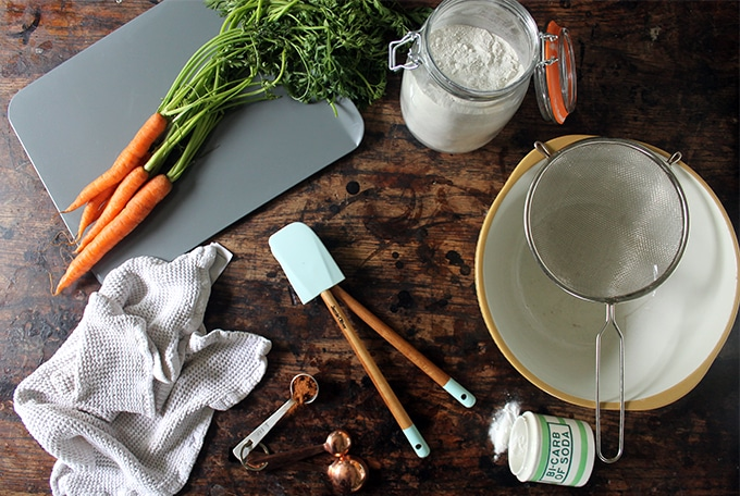 Ingredients laid out on wooden table for Cinnamon Carrot Soda Bread recipe