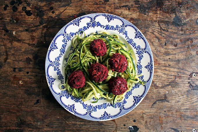 A plate of noodles and beet meatballs.