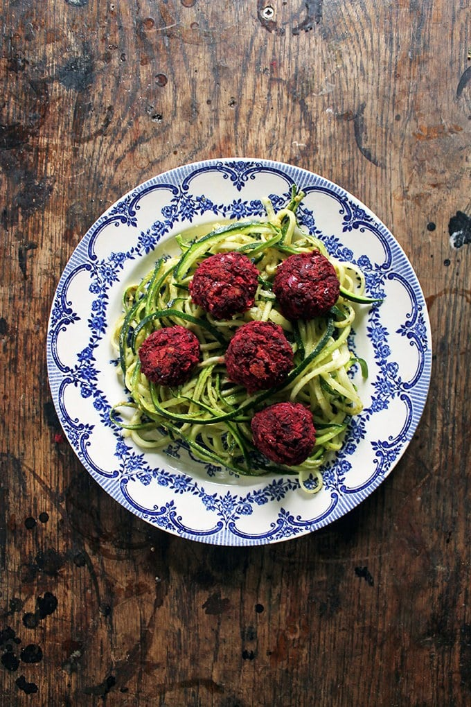 Courgetti (courgette noodles) and beet balls recipe. Beet balls are not only luminously purple, but they are nicely dense and packed with flavour from the toasted walnuts and herbs, which pair beautifully with the earthy beetroot.