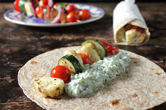 vegetarian souvlaki made with grilled halloumi and vegetables, in a wrap with homemade tzatziki sauce