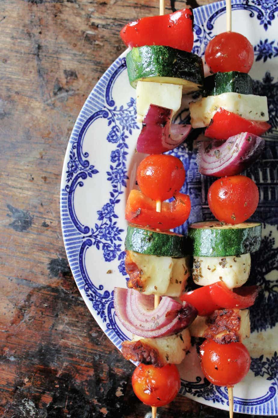 Skewers of souvlaki on a plate.