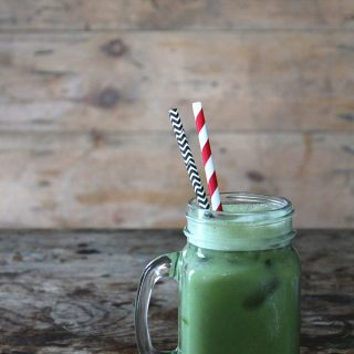 A glass of matcha horchata - a matcha twist on the classic mexican horchata drink. Vegan.