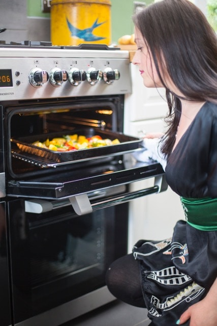 Kate Hackworthy opening oven.