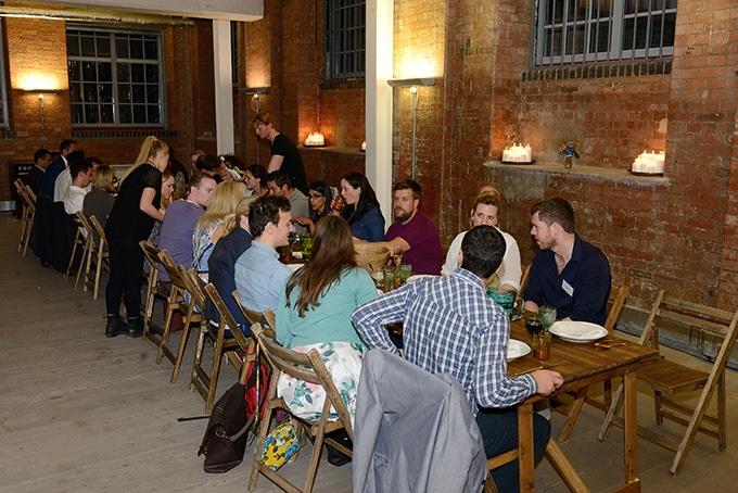 People around large dinner table.