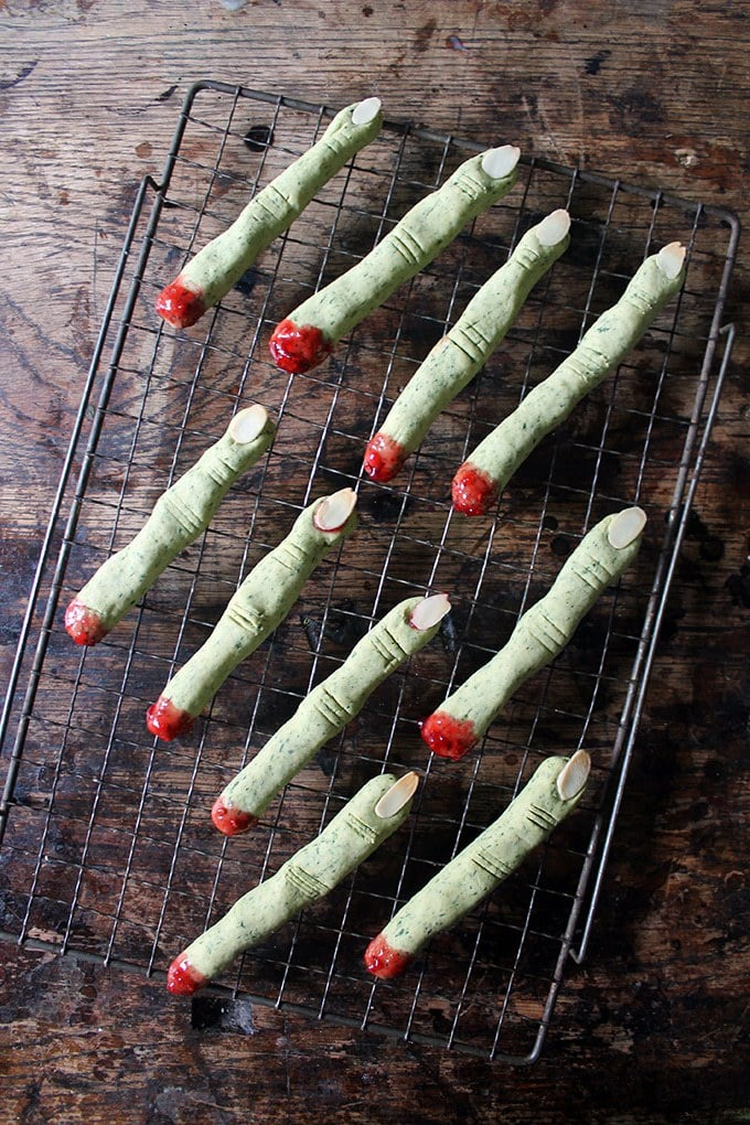 Rows of green witch fingers - cookies made from spinach (can't taste it!) to make them green, almond slivers for fingernails and jam at the bottom to show them as severed fingers.