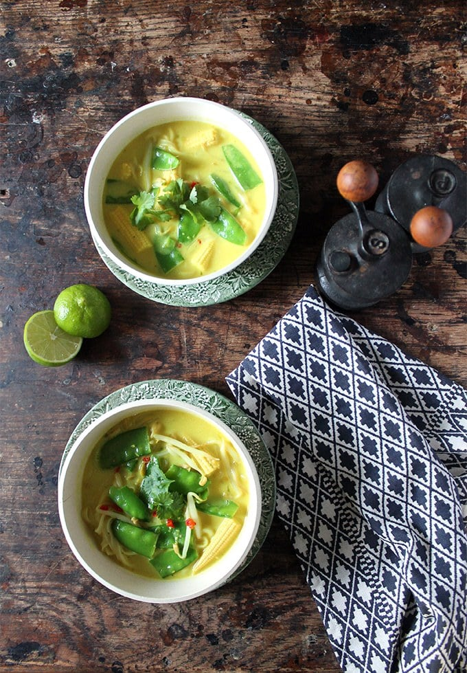 Bowls of soup on a wooden table.