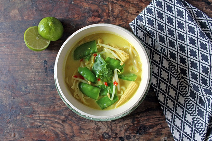 A bowl of quick and easy 15 minute vegan Malaysian laksa soup. Coconut milk, turmeric, vegetables and chilli all combine in this hearty and warming soup.