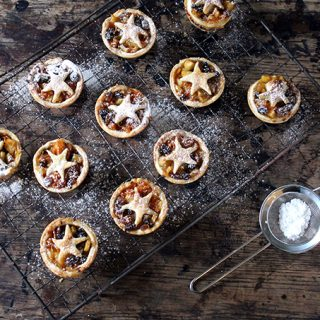Small tarts on a wire cooling rack.