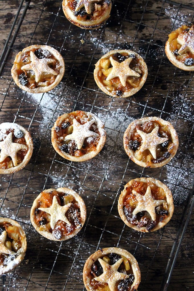 Healthy Carrot and Apple Mince Pies on a vintage cooling rack on a wooden table.