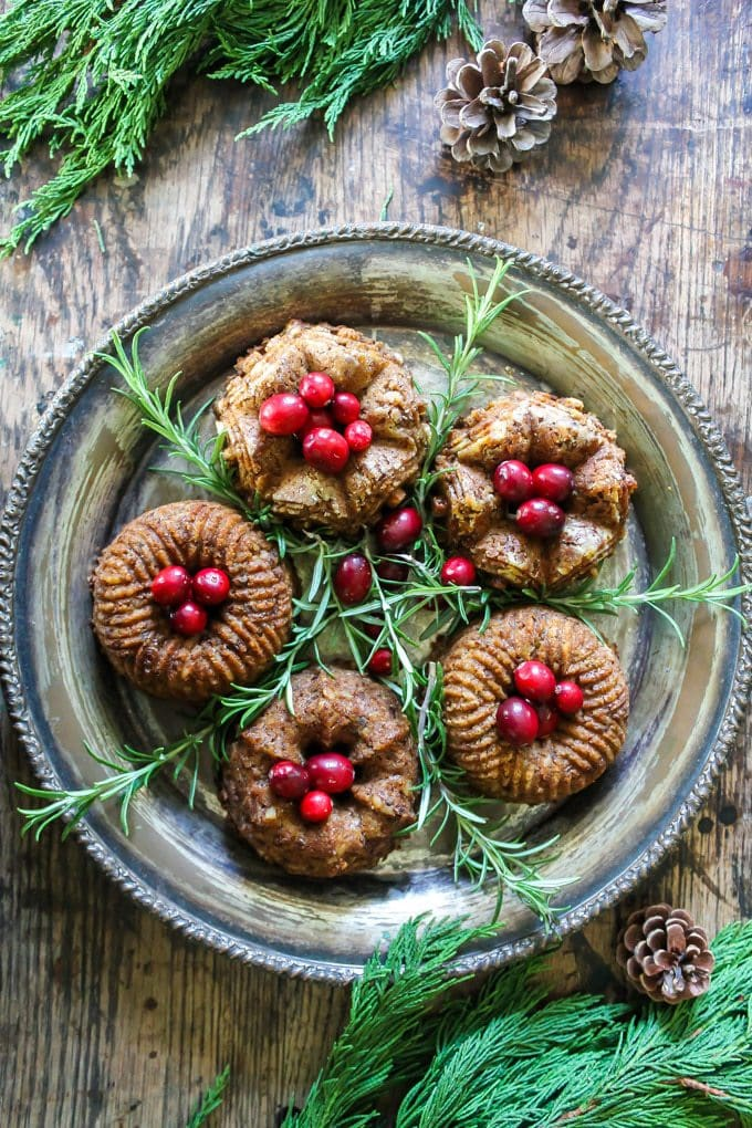 Mini bundt chestnut roasts on a vintage silver platter with cranberries piled on top with rosemary sprigs. Get the recipe.