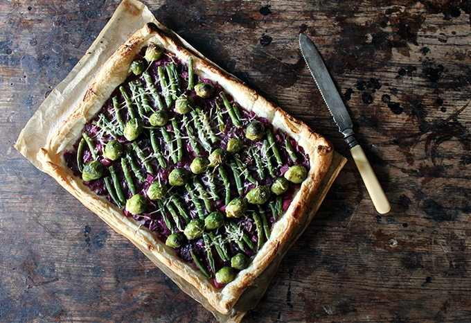 Red Cabbage and Sprout Tart on a table.
