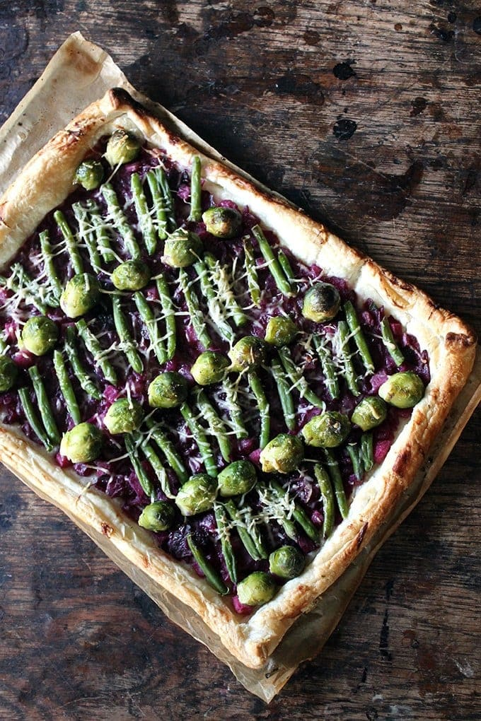 Tart with brussels sprouts and green beans on a bed of braised red cabbage.