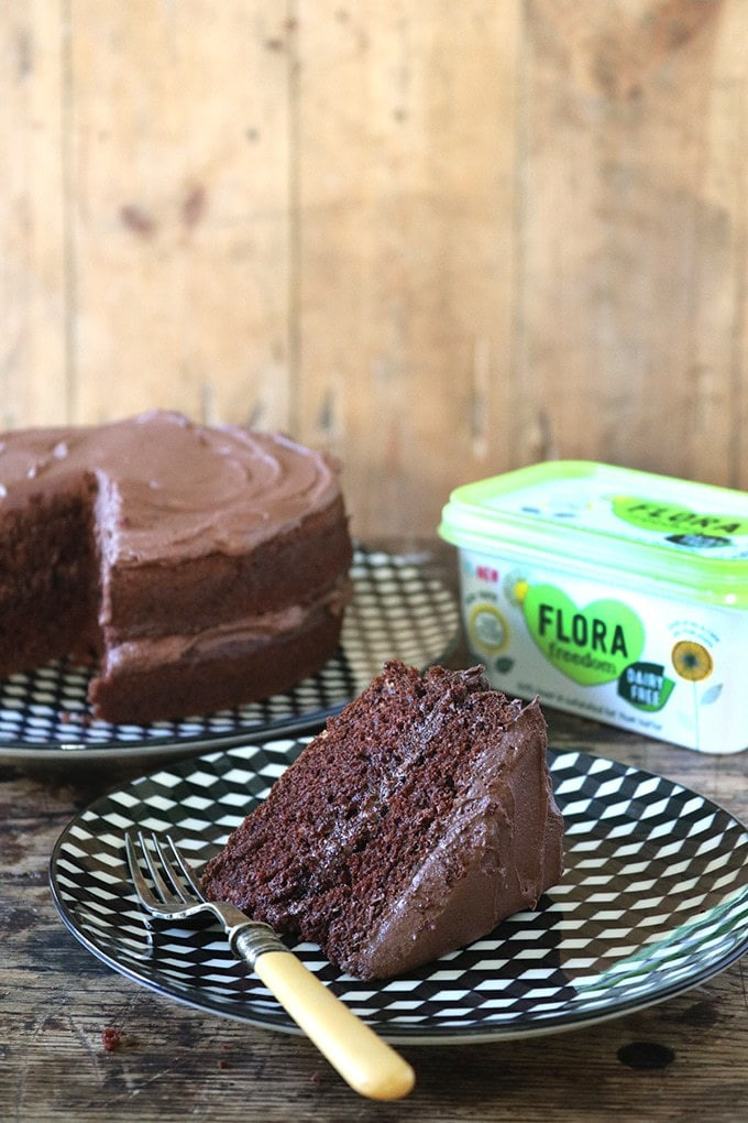 A moist and fluffy slice of the BEST vegan chocolate cake with vegan chocolate buttercream