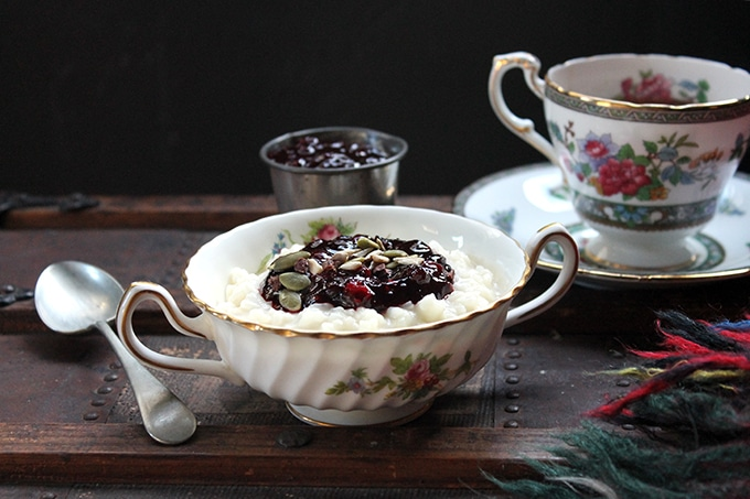 Vintage bowl full of rice pudding and berry compote.