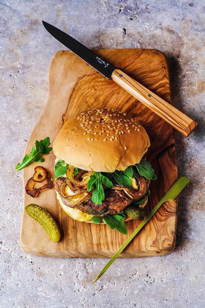 Easy Bean Burger with Mustard Mayo - ready in just 15 minutes, this flavourful burger uses refried beans to make it super quick. It's served with fried onions for extra flavour. #beanburger #vegan #veganburger #veganuary #veganrecipes #refiredbeans