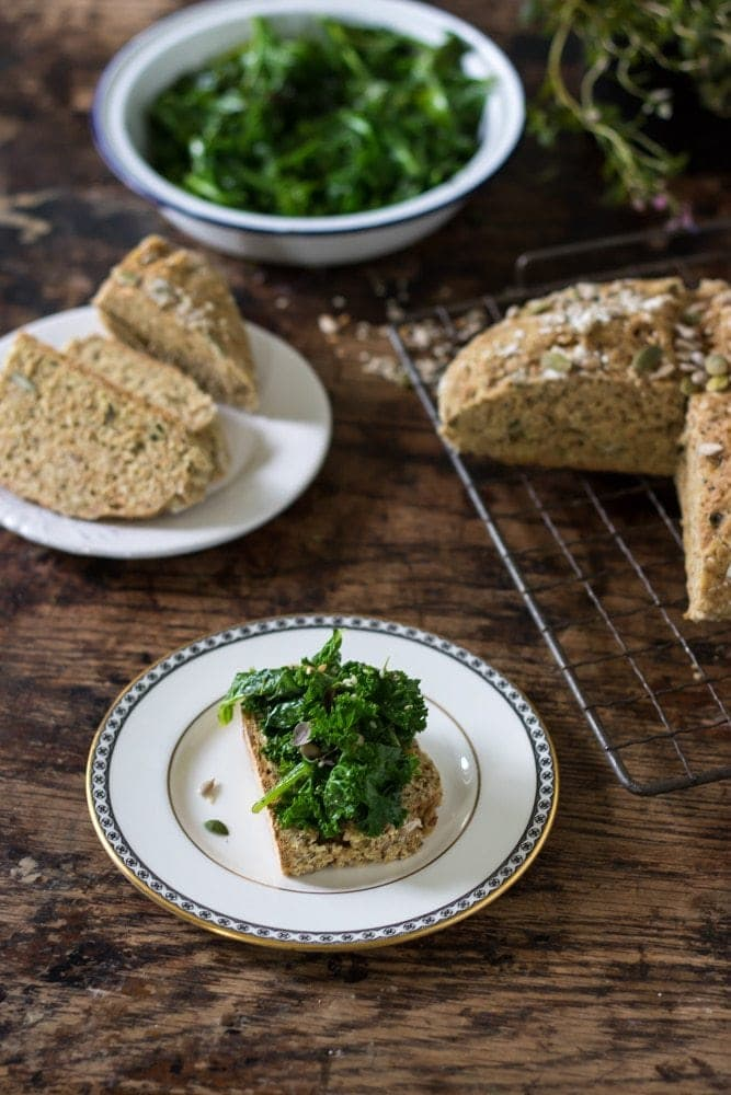 A slice of herby greens-topped seedy Irish soda bread
