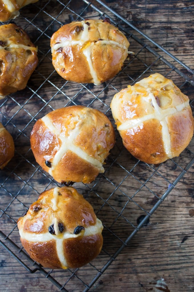 A cooling rack covered in Carrot and Ginger Hot Cross Buns - a fun twist on the classic Easter treat.