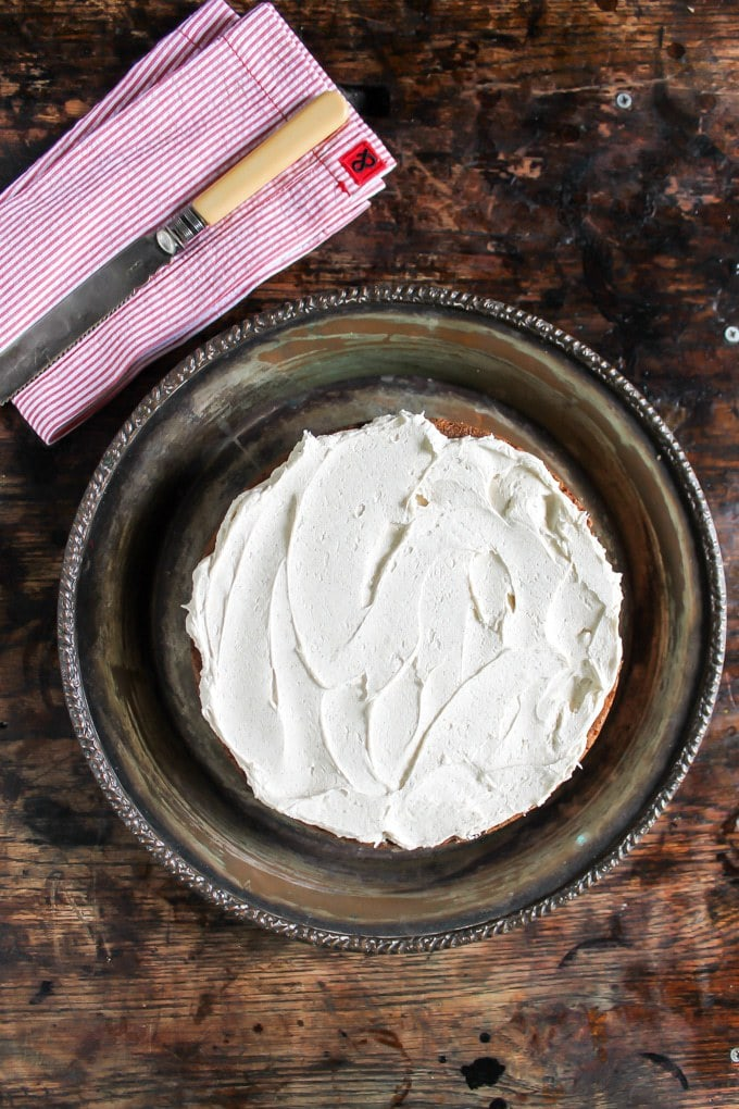 Carrot Peeling Cake with Cinnamon Icing photographed from above on a vintage silver platter