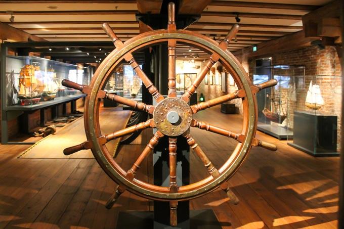 A ships wheel in a museum.