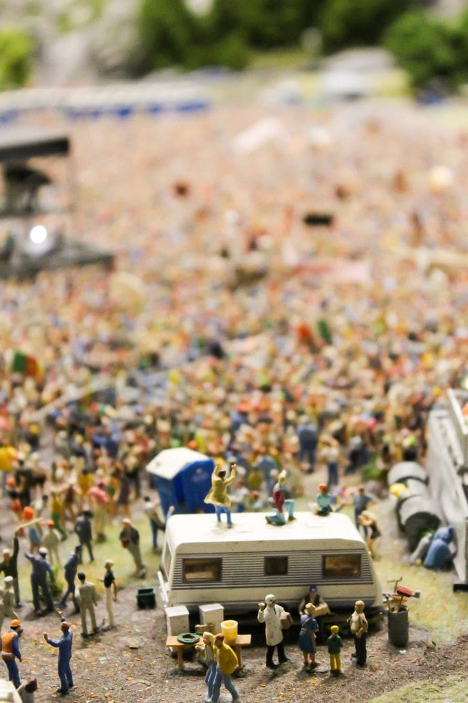 A model of a group of people at a festival.