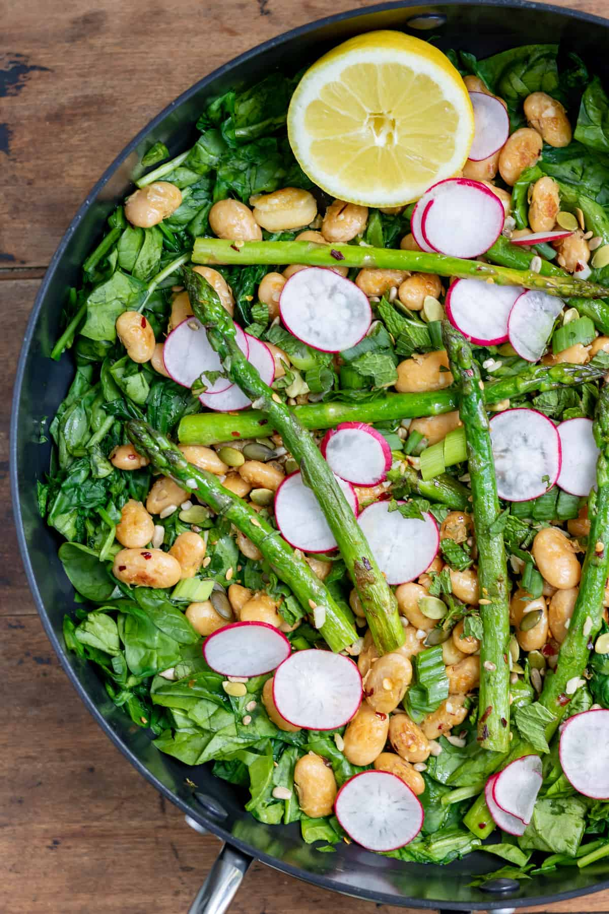 Close up of warm salad in a pan.